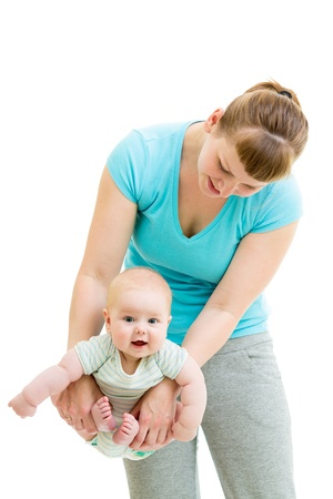mother doing yoga with baby isolated photo