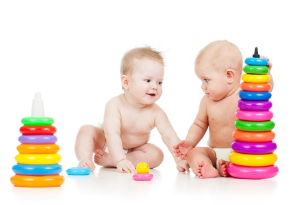 developmental: babies play with color developmental toys Stock Photo