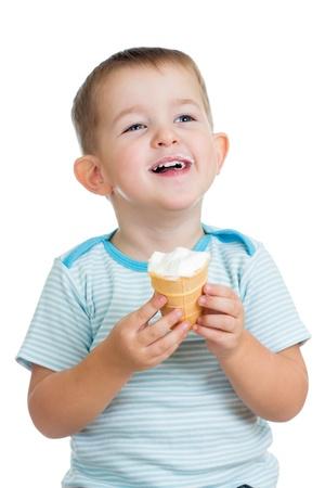 eating ice cream: smiling kid boy eating ice cream in studio