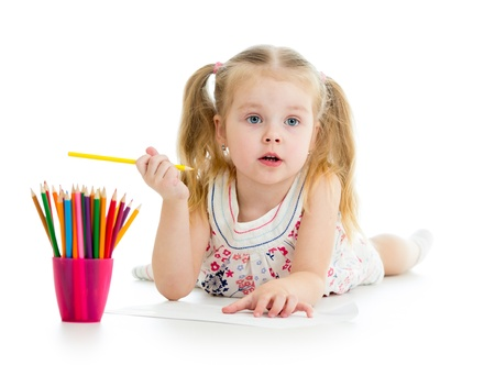 Cute girl drawing a picture with color pencils photo