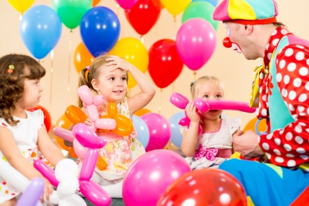 kids group and clown on birthday party photo
