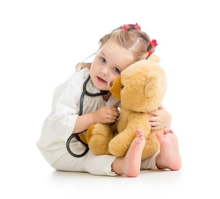 doctor toys: child with clothes of doctor playing toy Stock Photo