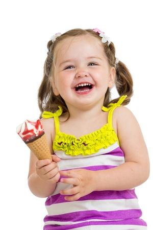 cheerful kid girl eating ice cream isolated photo