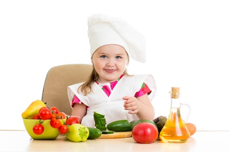 Chef kid preparing healthy food Stock Photo - 21075092