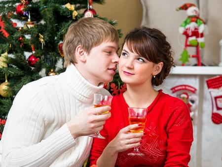 young couple drinking champagne at Christmas tree home Stock Photo - 21075158