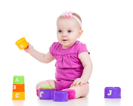 baby girl playing toys photo