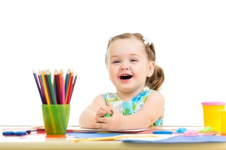 craft material: smiling child drawing and making by hands