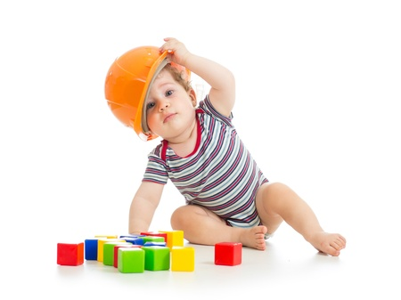 constructors: little boy with hard hat and building blocks Stock Photo