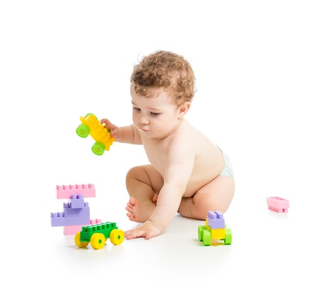 child boy with construction set over white background photo