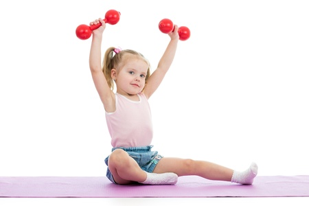 Kid doing exercises with dumbbells photo