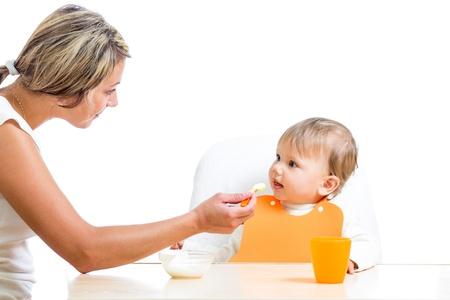 baby feeding: mother feeding her daughter