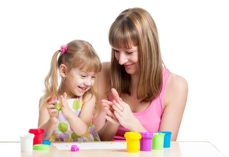 little dough: kid girl and mother playing colorful clay toy