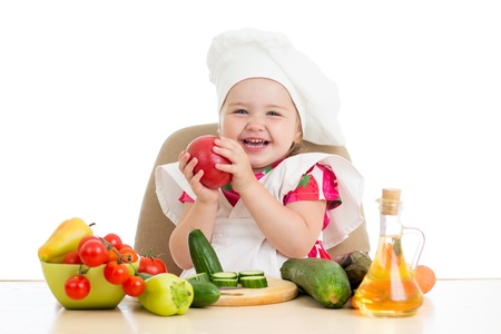 scullion little girl with vegetables isolated on white