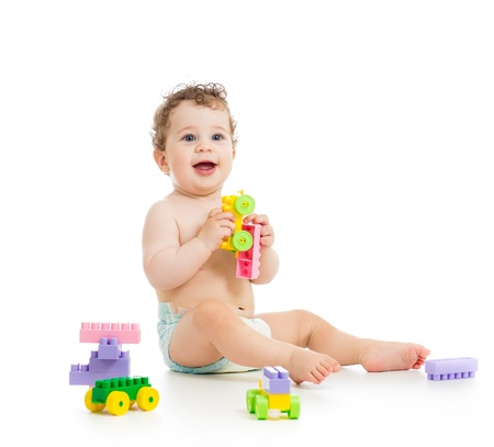 assiduous: cute child boy with construction set over white background Stock Photo