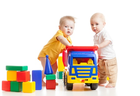 two little children play with block toys photo