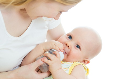 mother feeding baby from bottle photo
