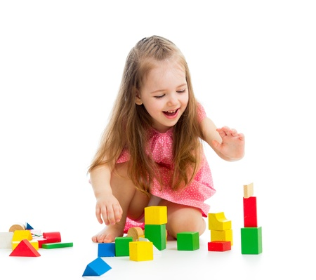 little girl sitting: kid girl playing with toys Stock Photo