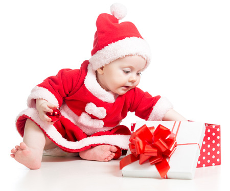Santa Claus baby girl opening gift box isolated on white background photo