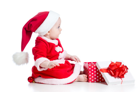 christmas baby girl opening gift box isolated on white background photo