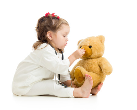 pediatric nurse: child girl playing doctor with toy Stock Photo
