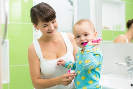mother with baby brushing teeth Stock Photo - 22249616