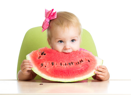 child girl eating watermelon photo