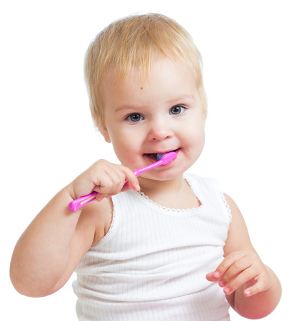 child girl brushing teeth isolated on white photo
