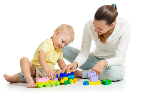 child boy and his mother play together with construction set toy Stock Photo - 22350687