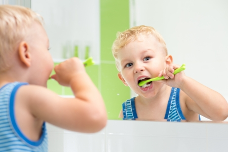 routines: kid boy brushing teeth Stock Photo