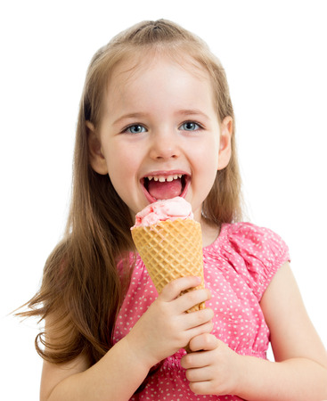 smiling kid girl eating ice cream isolated photo