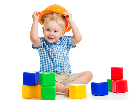 kid boy playing with building blocks toy photo