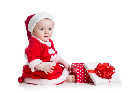x-mas baby girl opening gift box isolated on white background photo