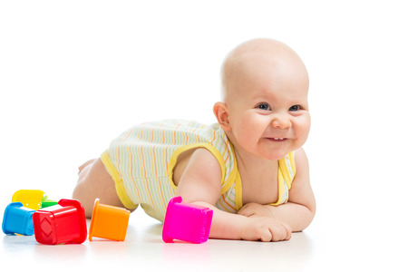 baby boy playing with cup toys photo