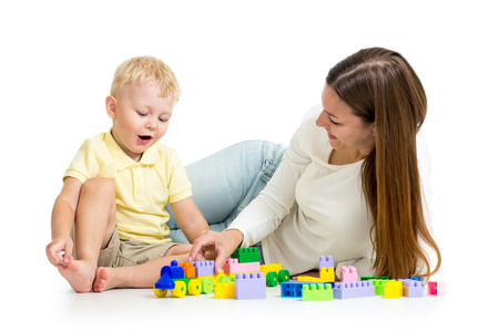 child and his mom play together with block toy photo