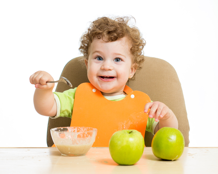 singly: baby eating by himself