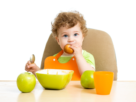 singly: baby boy eating by himself