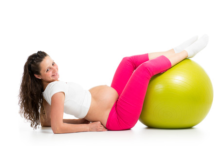 Pregnant woman excercises with gymnastic fit bal photo