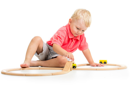 child playing rail road toy photo