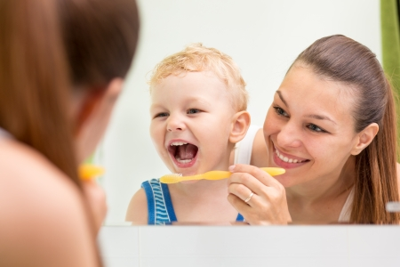 teeth: mother teaching kid teeth brushing Stock Photo