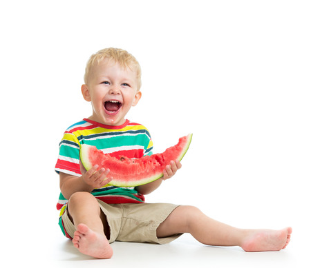 Kid boy eating watermelon isolated on white photo