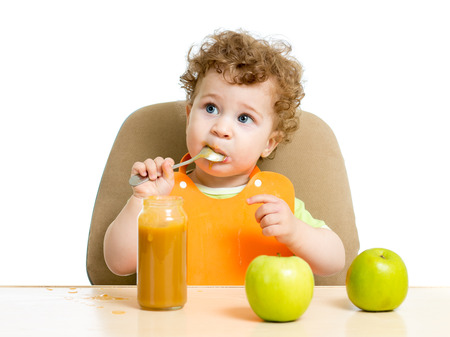 singly: baby eating sauce by himself