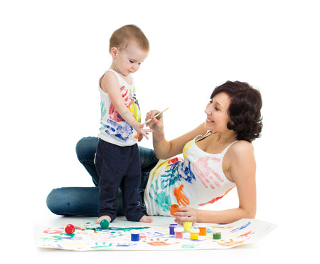 mother wih kid boy drawing and painting together photo