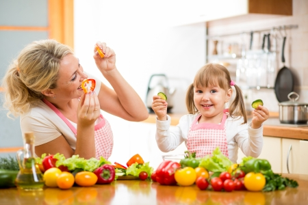 mother and kid preparing healthy food photo