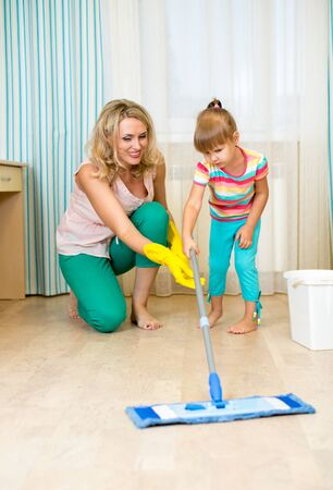 mother and kid clean room and having fun Stock Photo - 22708613