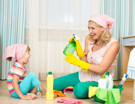 mother with kid cleaning room and having fun Stock Photo - 22708614
