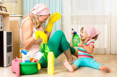 happy mother with kid cleaning room and having fun photo
