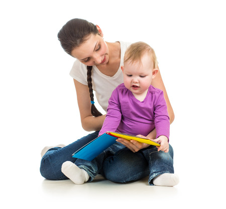 mother reading a book to her baby daughter photo