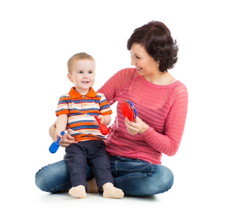 Mother and baby boy play with musical toys photo