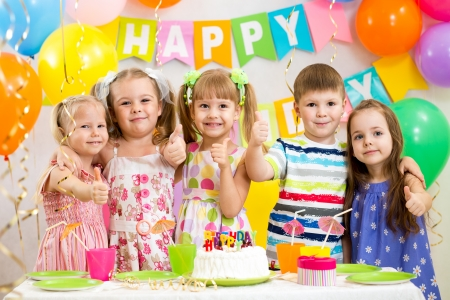 children celebrating birthday party photo