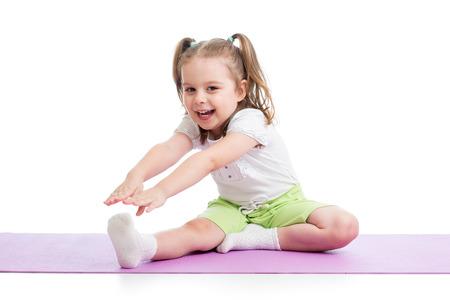 kids exercise: Child girl doing fitness exercises Stock Photo